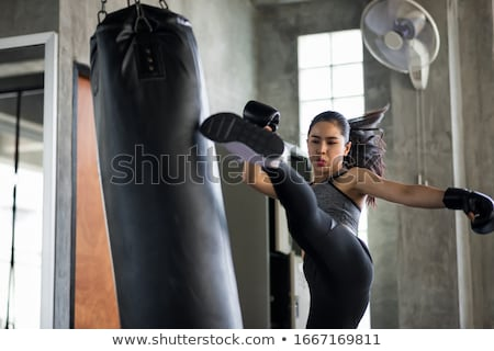 girl boxing punching bag stock photo © lenm