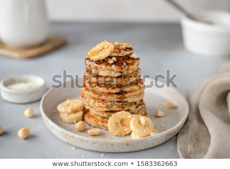 Stockfoto: Pancakes With Walnuts Dates And Date Syrup