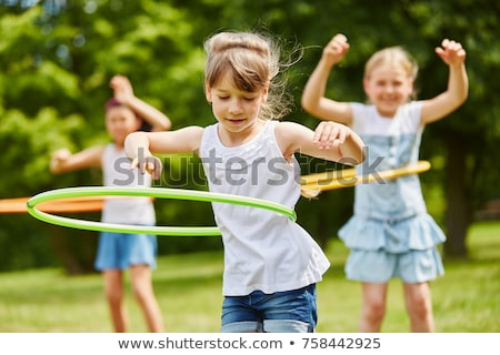 young girl playing with hoop Stock photo © IS2