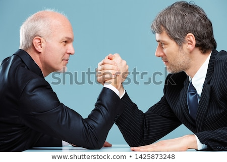 Businesspeople staring at each other Stock photo © IS2