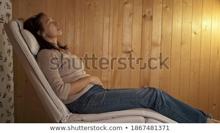 женщину · спальный · кресло · покрытый · комнату - Сток-фото © is2