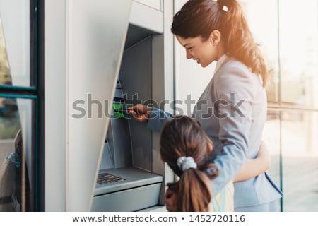 Kadın nakit makine para kadın ayakta Stok fotoğraf © IS2