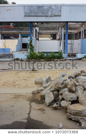 Pieces of Metal and Stone are Crumbling from Demolished Building Floors Stock photo © AlisLuch