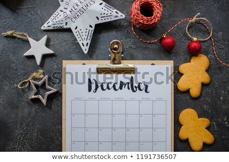 Desk calendar page for year end review. Stock photo © vinnstock