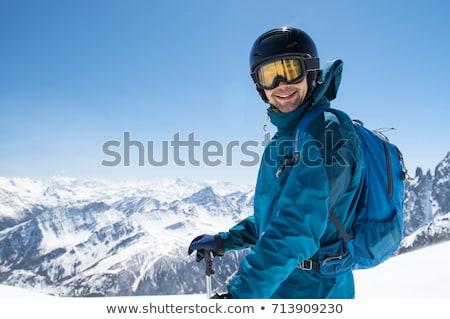 joven · esquí · nieve · invierno · cielo · azul · vacaciones - foto stock © is2