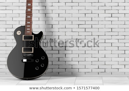 Foto stock: Electric Guitar And Brick Wall Background