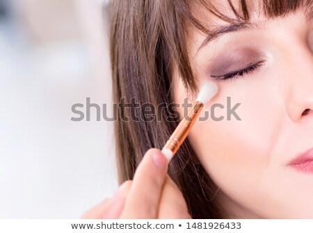 Сток-фото: Man Doing Make Up For Cute Woman In Beauty Salon
