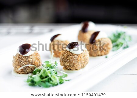 gourmet organic scotch quail eggs starter snack on table Stock photo © travelphotography