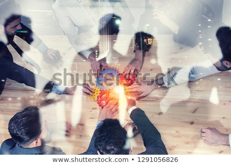 Stok fotoğraf: Business Team Connect Pieces Of Gears Teamwork Partnership And Integration Concept Double Exposur