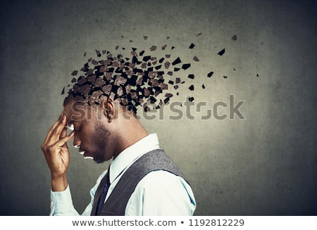 Side profile of a sad man losing parts of head as symbol of decreased mind function. Stock photo © ichiosea