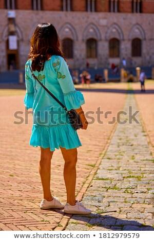 Mulher turquesa vestir sessão cadeira Foto stock © acidgrey