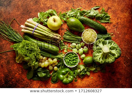 Fresh green vegetables and fruits assortment placed on a rusty metal Stock photo © dash
