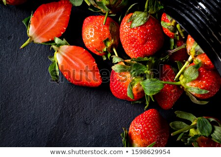 Healthy ripe strawberry. Organic freshly picked berry with green leaves. Food background. Top view Stock photo © artjazz