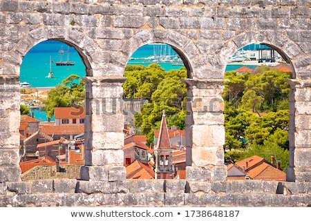 Trogir church and turquoise waterfront view through stone window Stock photo © xbrchx