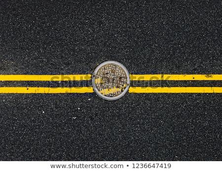 Manhole cover metallic backdrop Stock photo © boggy