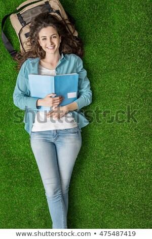 Gülen öğrenci park gülümseme okul yeşil Stok fotoğraf © Minervastock