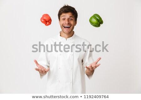 érzelmes fiatal szakács izolált fehér tart Stock fotó © deandrobot