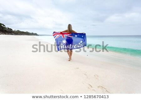 mulher · caminhada · idílico · praia · australiano · bandeira - foto stock © lovleah