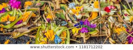 Offerings to gods in Bali with flowers, food and aroma sticks Stock photo © galitskaya