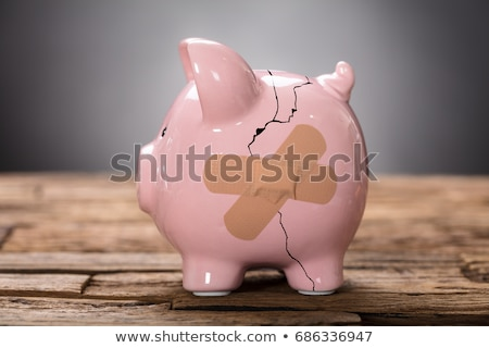 broken pink piggybank with bandage stock photo © andreypopov