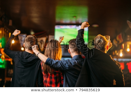 happy friends of football fans watching soccer on tv and celebrating victory stock photo © alphaspirit