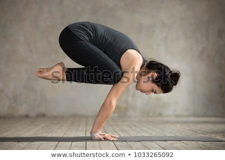 young woman doing crane pose at yoga studio Stock photo © dolgachov