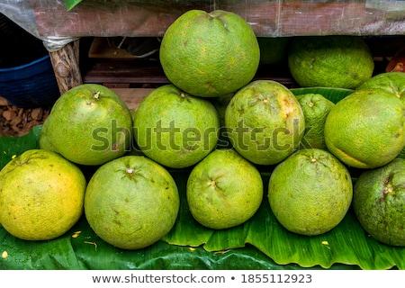Organic pomelo or thai grapefruit for sale in market Stock photo © galitskaya
