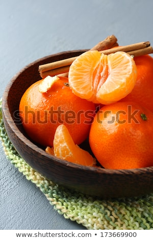 Bowl of fresh mandarins on green knitted napkin Stock photo © Melnyk