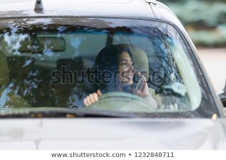 Mulher jovem motorista móvel olhando fora Foto stock © Giulio_Fornasar