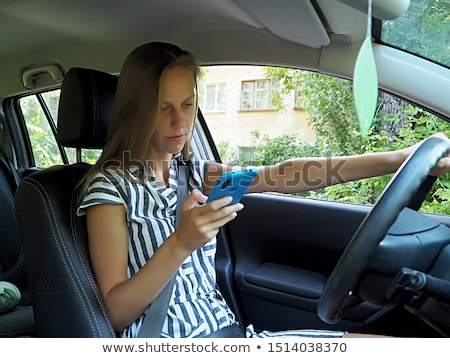 Young woman driver talking on her cellphone Stock photo © Giulio_Fornasar