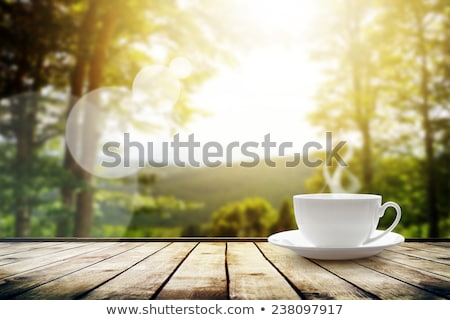 Green coffee cup over green background Stock photo © karandaev