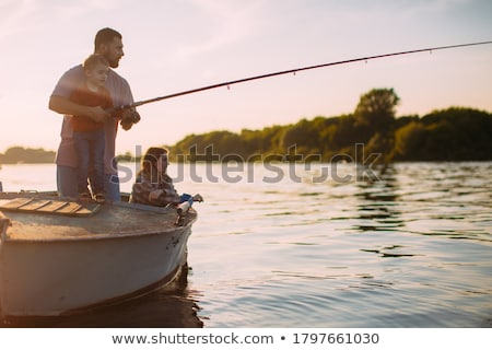 Male Fishing in Lake, Swimming in River at Boat Stock photo © robuart