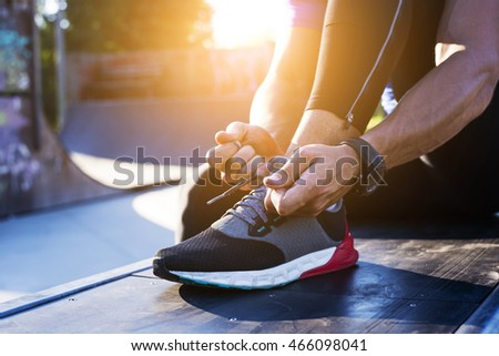 Man tying up shoe laces Stock photo © photography33