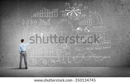 Rear view of businessman writing with a white chalk Stock photo © wavebreak_media