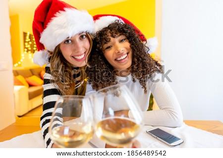 Happy couple toasting glasses of wine Stock photo © wavebreak_media