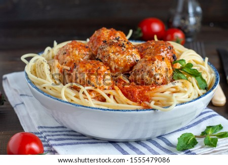 Spaghetti rolled in balls with tomatoes Stock photo © dash