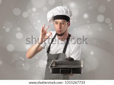Male cook with shiny grey wallpaper Stock photo © ra2studio