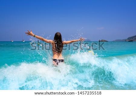 Ibiza beach girl splashing water in Balearics Stock photo © lunamarina