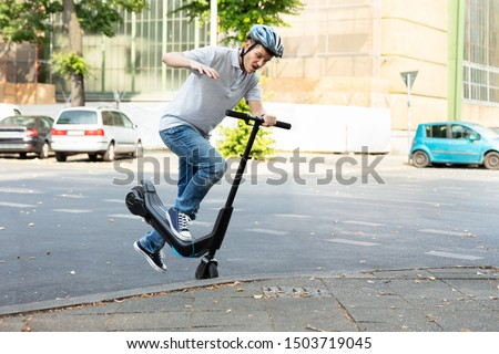 Man Falling From E-Scooter Stock photo © AndreyPopov