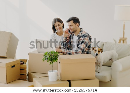 Busy male homeowner calls in delivery service via modern smartphone, makes order online, focused in  Stock photo © vkstudio