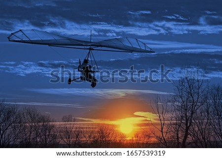 The motorized hang glider fly in the sunset. Classic Blue Panton Stock photo © smuki