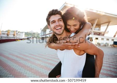 Boldog fiatal barna hajú lezser gyönyörű fehér Stock fotó © zdenkam