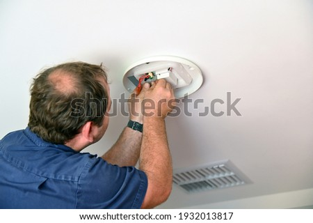 electrician installing celling light house worker repairman stock photo © taiga