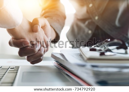 Stock photo: Close up of a business handshake, finishing up a meeting acquisi