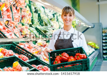 Woman working in a supermarket sorting fruit and vegetables Stock photo © Kzenon