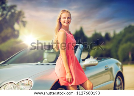 woman in convertible car over evening sky Stock photo © dolgachov
