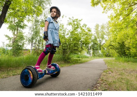 Girl Riding on Personal Transporter in Park Stock photo © robuart