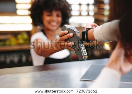 Making contactless payment with smartwatch Stock photo © pressmaster