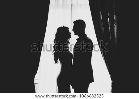 Silhouettes of couple or two lovers photography together, Shadow on the Ground, Woman gesture a hear Stock photo © galitskaya