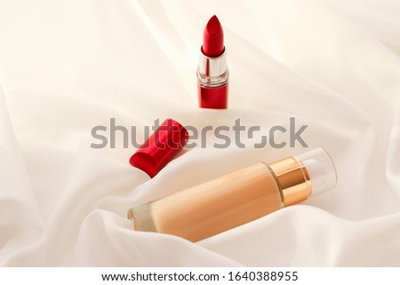 beige tonal cream bottle make up fluid foundation base and pink stock photo © anneleven